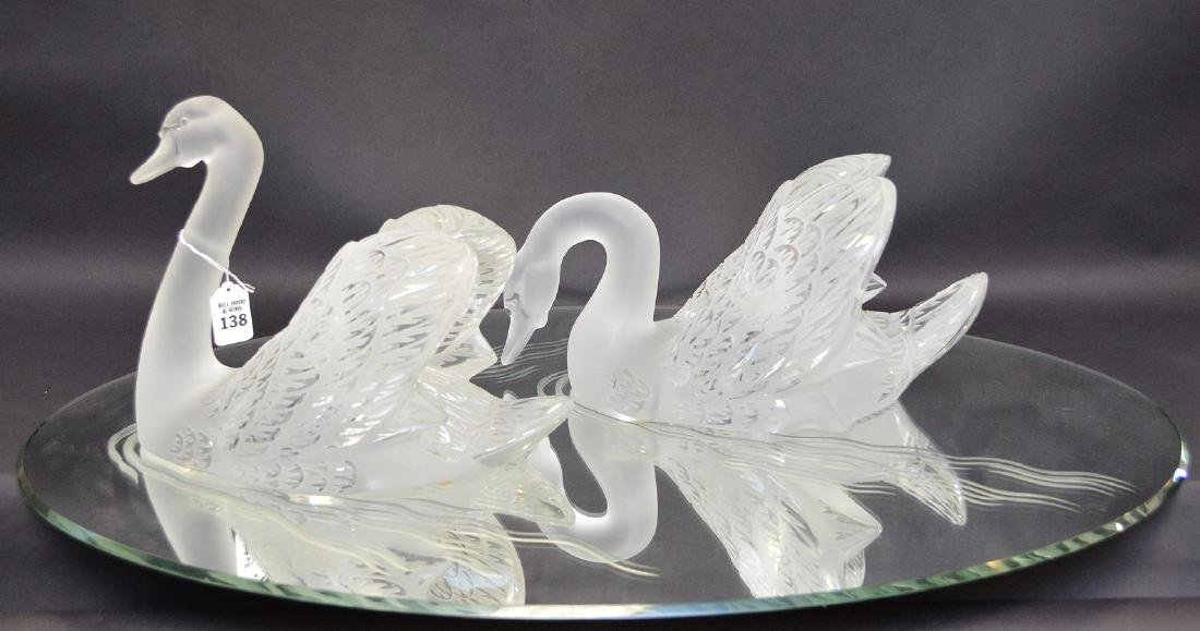 """Pair Lalique crystal swans, 10""""h x 12""""w."""