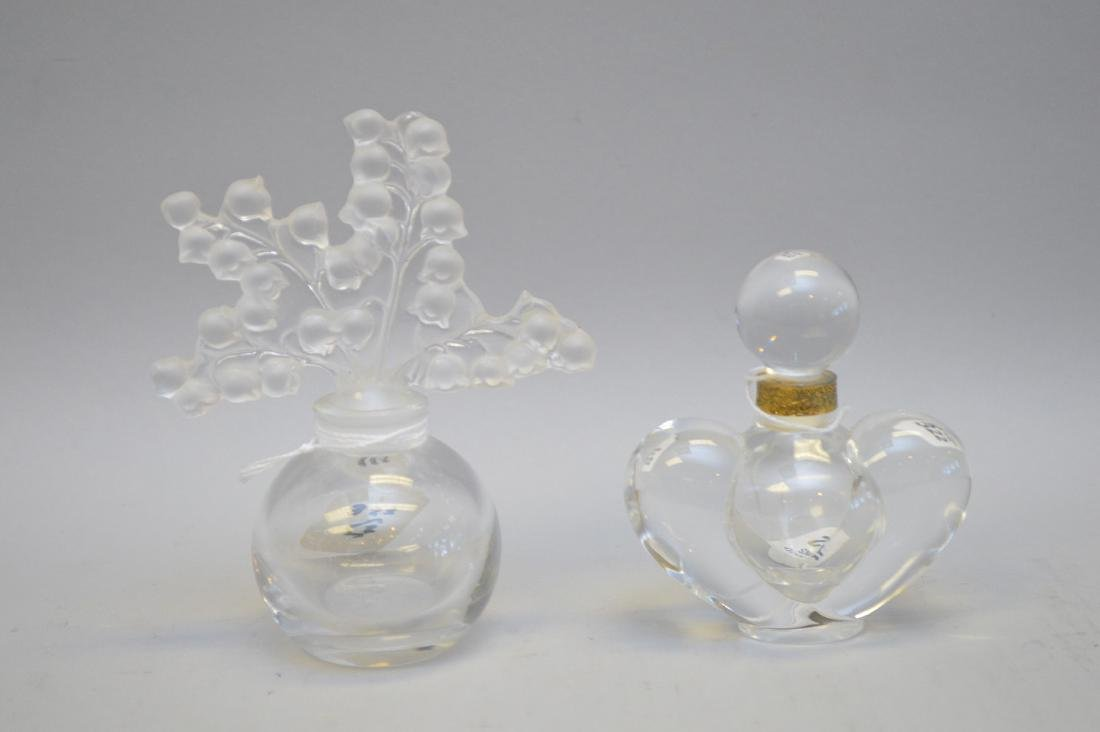 Two vintage Lalique Perfume Bottle. Lilly of the Valley