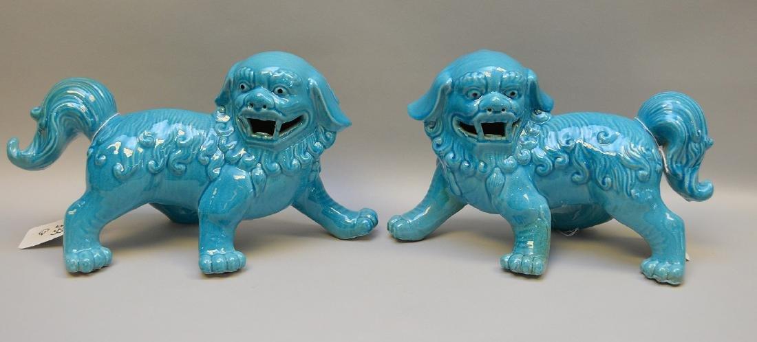 """Pair 20th c. ceramic dogs, 7""""h x 12 1/2""""w"""