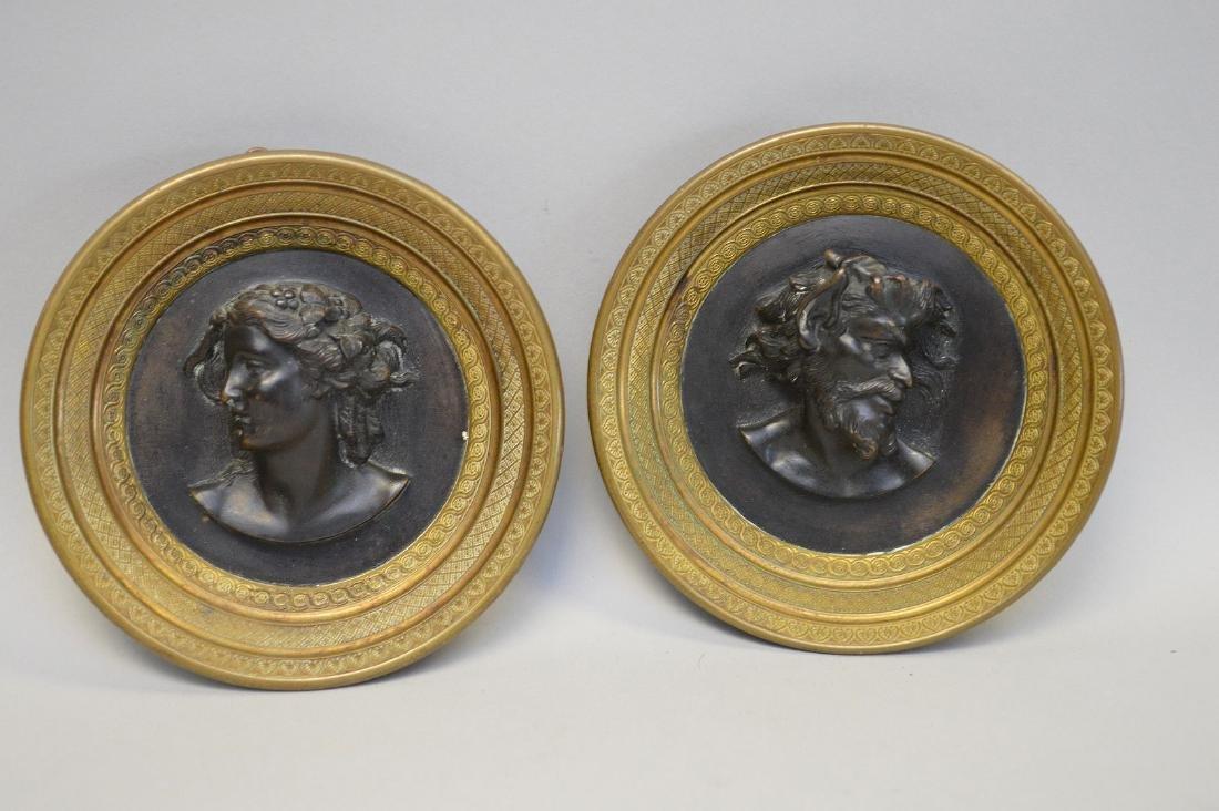 "Pair round bronze framed heads, 5""dia"