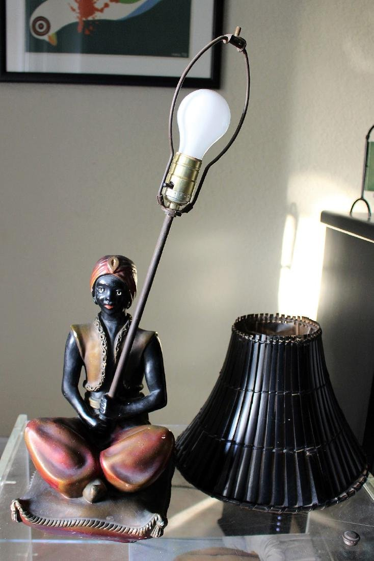 Seated blackamoor lamp, painted metal with bamboo