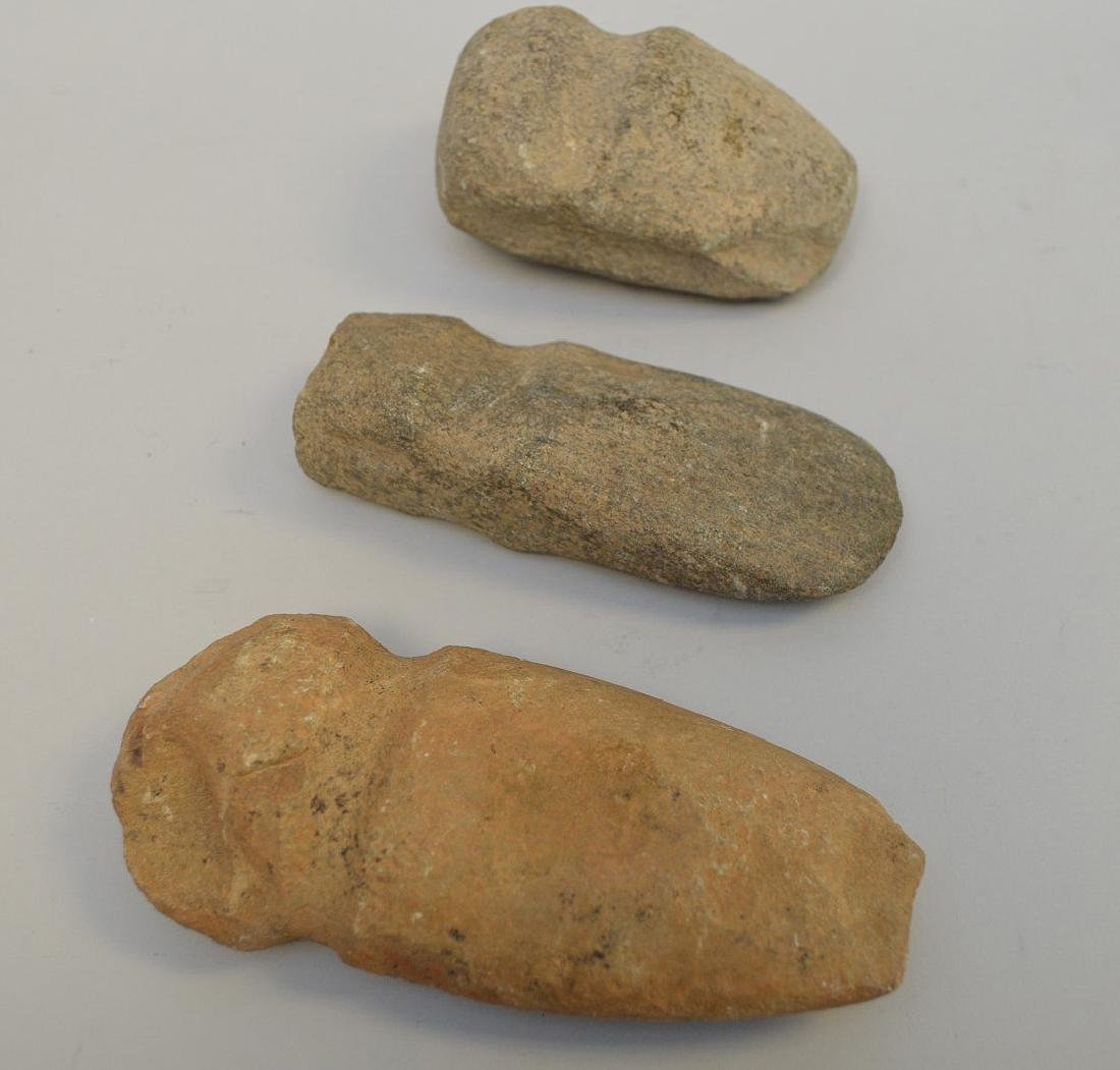 "Three Pre-Columbian stone axe heads, 3 3/4"" to 5 5/8""."