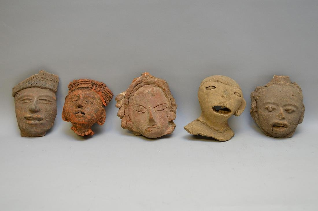"""Five Pre-Columbian Pottery heads. Approx. 6"""" x 6""""."""