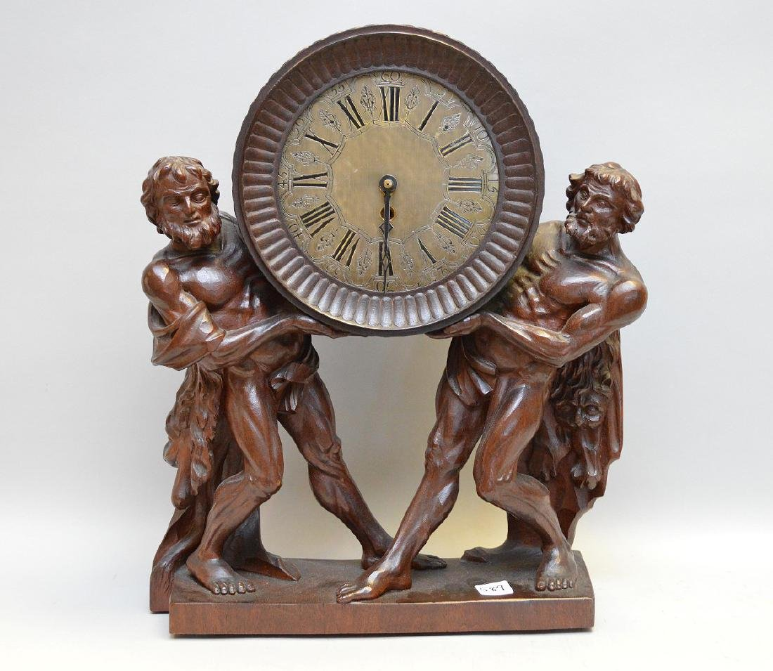"Carved wood 19th c. figural clock, 18""h x 14""w"