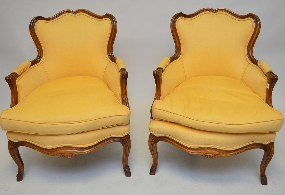 Pair yellow upholstered French style arm chairs