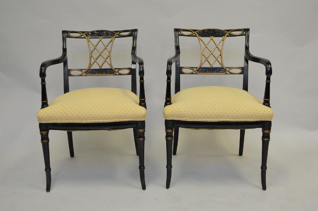 Pair ebony arm chairs with gilt accents, yellow