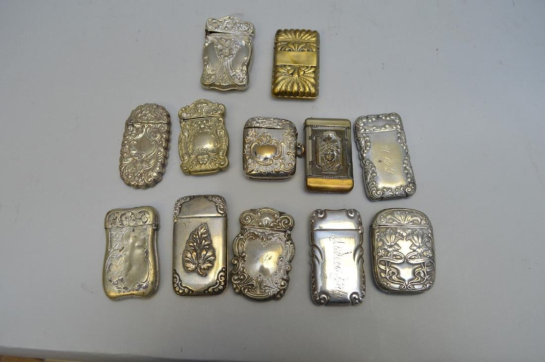 12 vintage silver plate match safes