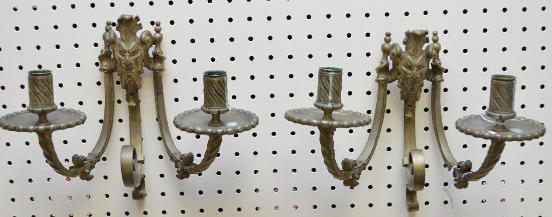 "Brass double branch wall sconces with masks, 10""h x"