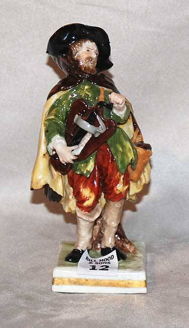 "1012: Made in Germany figurine of fellow, 5 3/4""h"