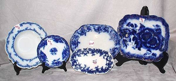 1016: 12 chipped English Staffordshire Flo-blue pieces,