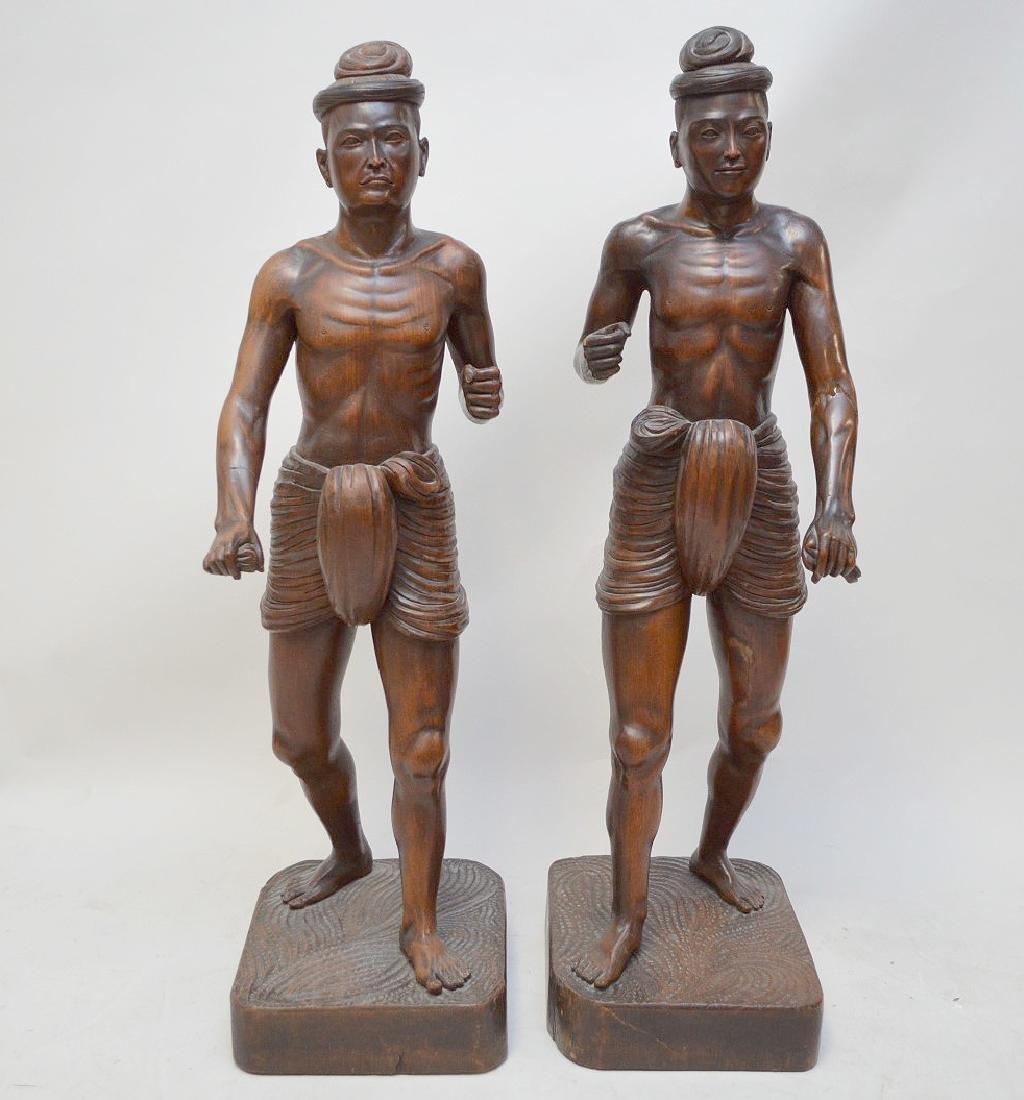 Pair Balinese carved wood figures (missing spears)