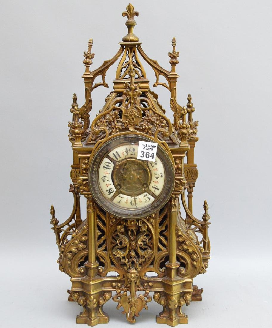 Antique bronze mantle clock, with time and strike