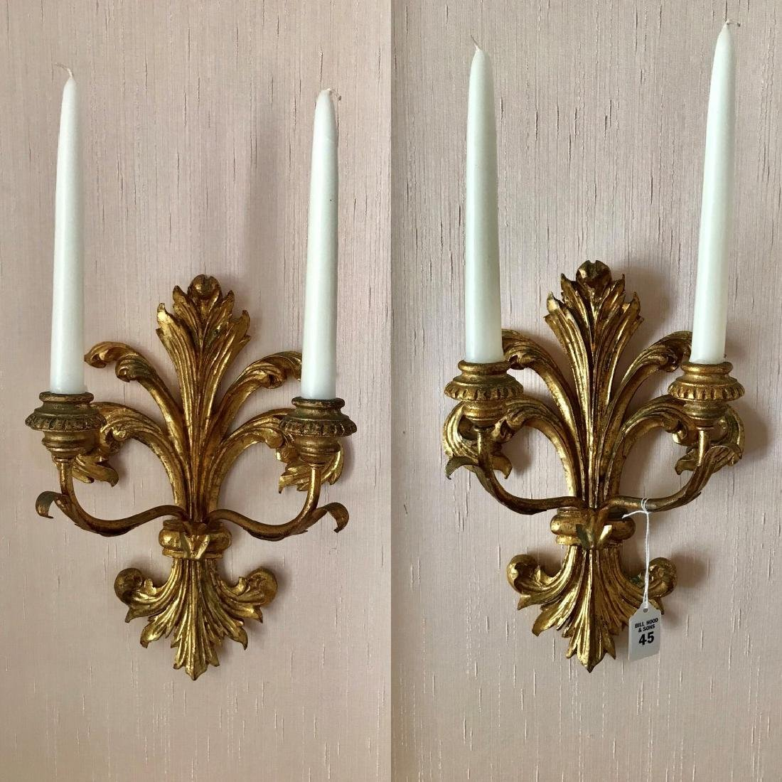Pair of Carved Gilt Wood Two-Light Candelabras.