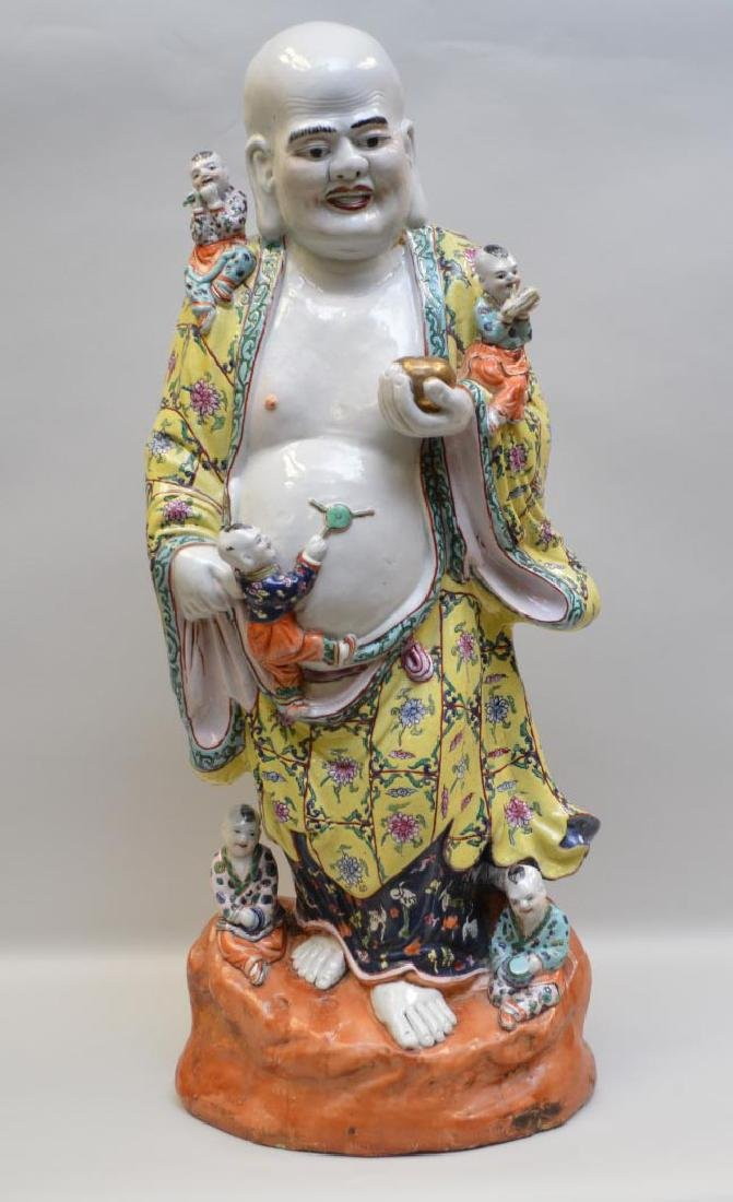 Early Chinese Porcelain Figural Group depicting a man