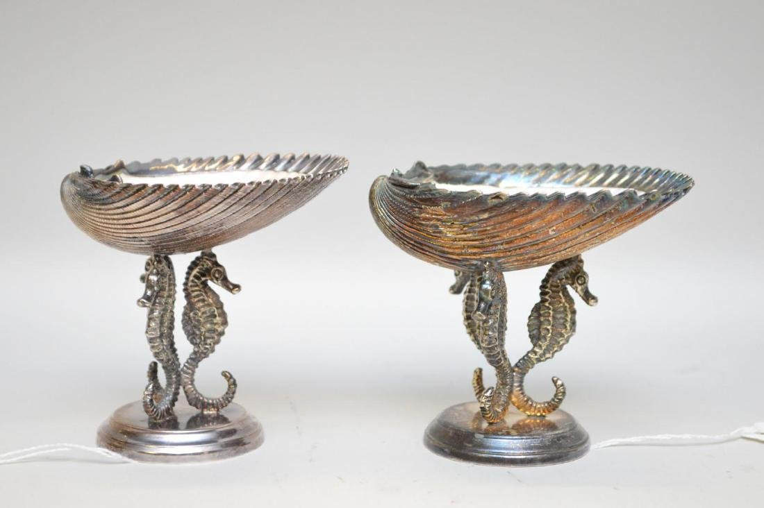 Pair of .800 Silver-Clad Sea Shells standing on Sea