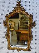 Carved Italian Gilt Wood Mirror, with floral and scroll