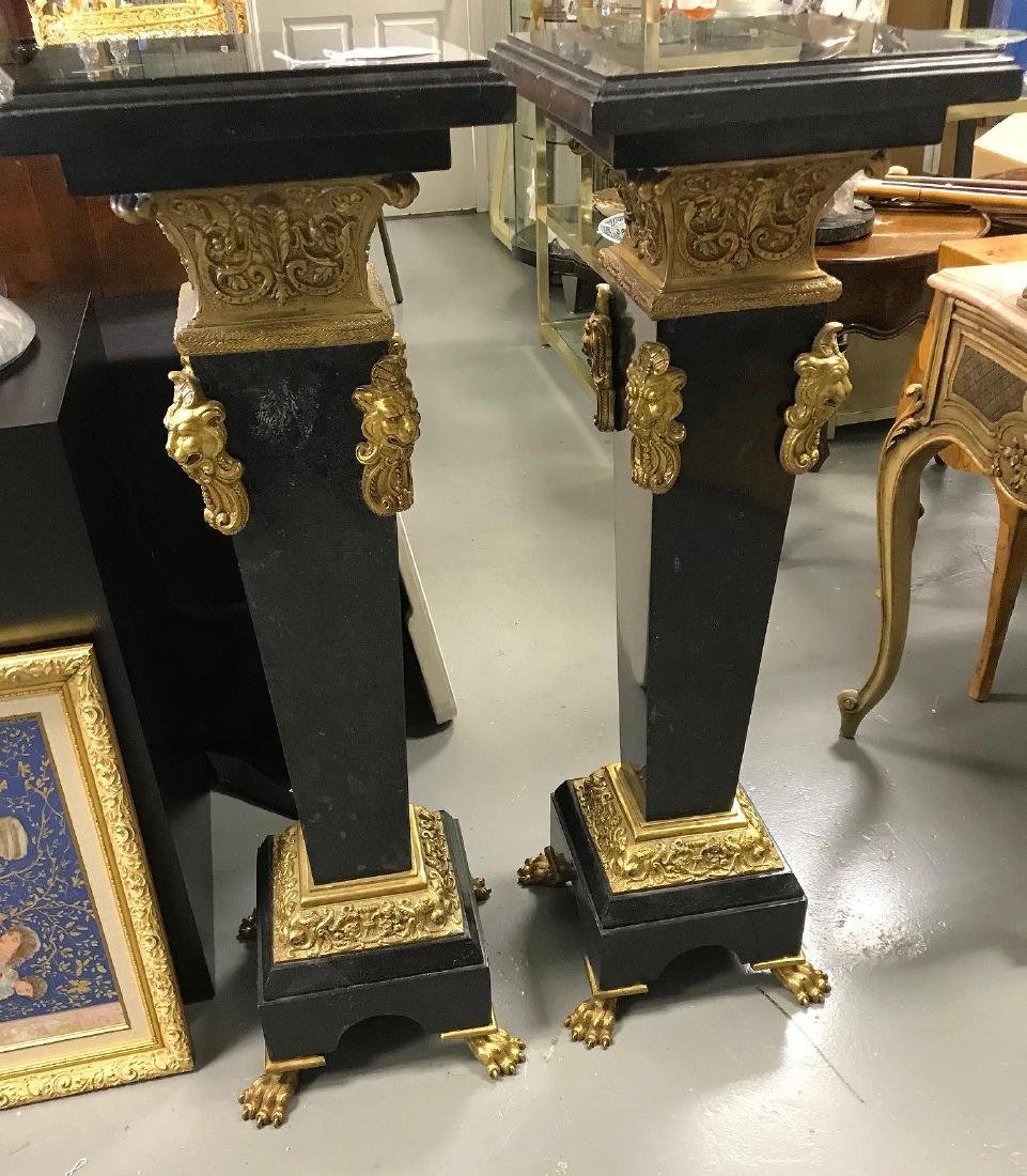 Pair black marble and bronze Pedestals with elaborate