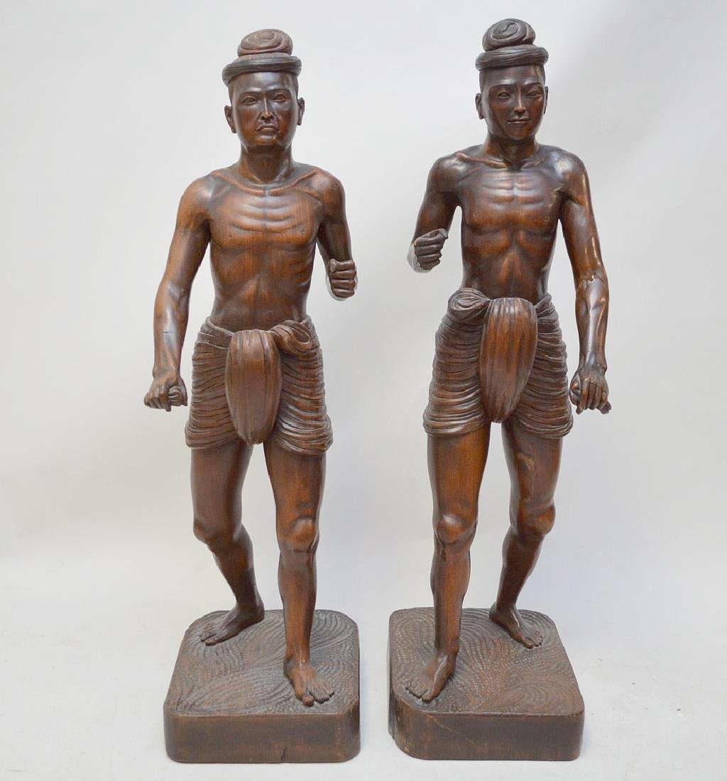 Pair Balinese carved wood figures on square wood base,