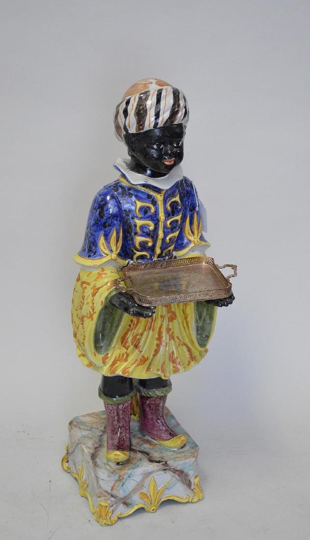 Italian diminutive blackamoor with a small silver plate