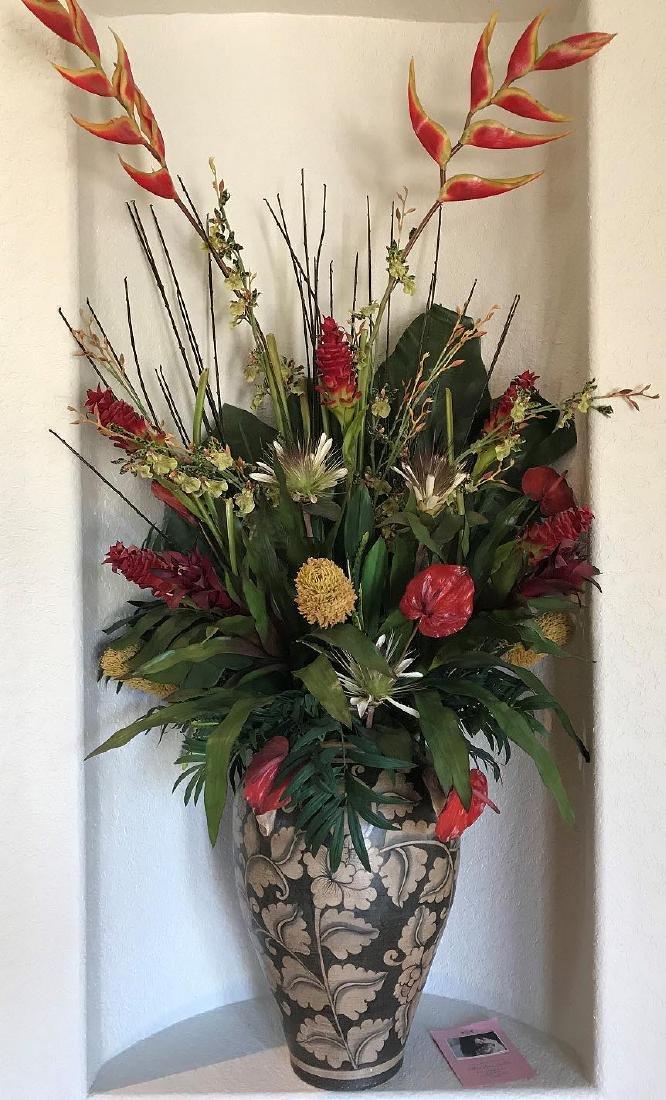 Pair Pottery decorative vases with floral arrangements,
