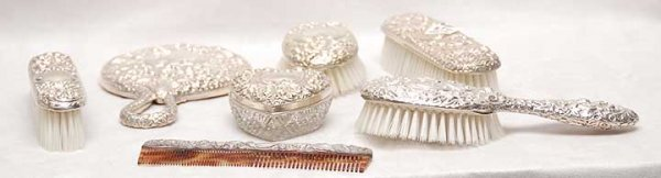 1004: 7 Piece repousse sterling silver dresser set, Ame