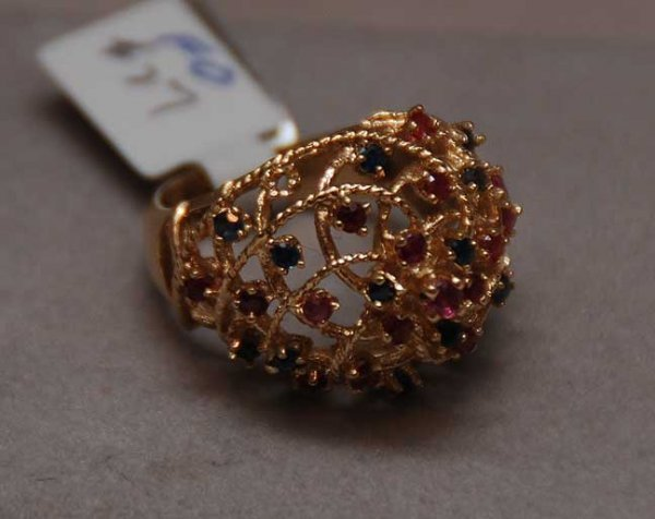 1018: 14kt Filigree bee hive ring with rubies sapphires