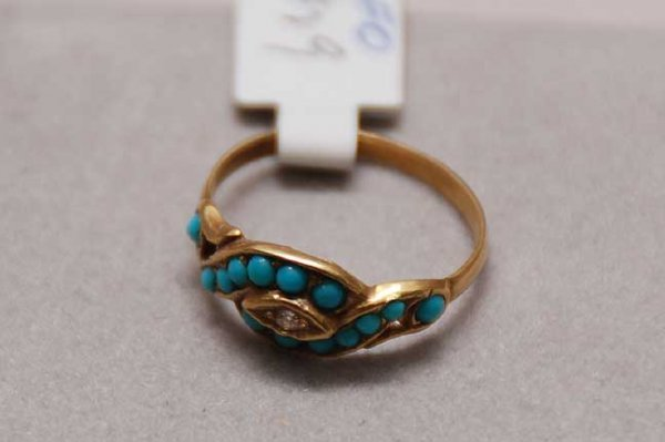 1020: Cabochon turquoise braided style ring w/ diamond
