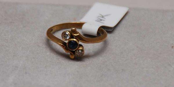 1021: 14kt Sapphire and diamond ring bezel set stones