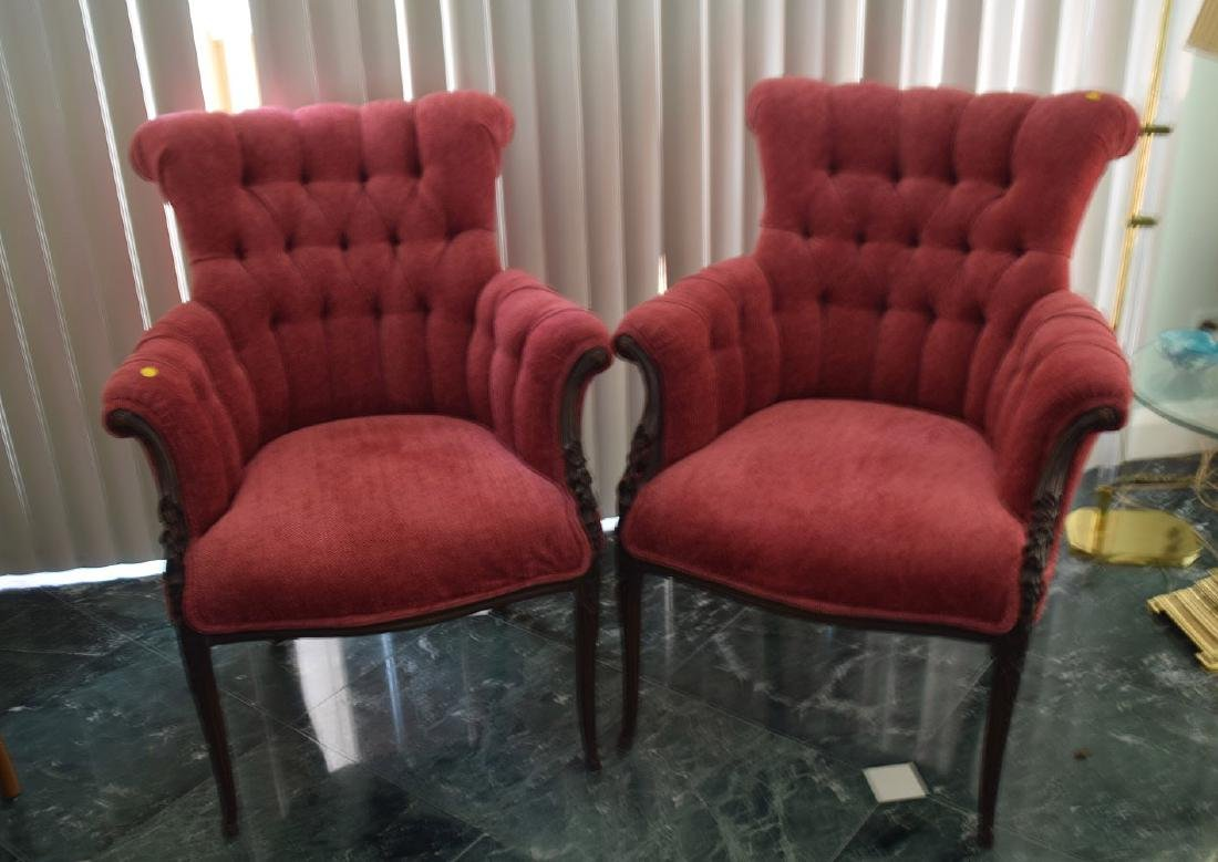 Pair tufted back red upholstered arm chairs with carved