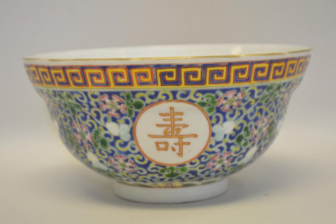 Chinese Porcelain Bowl with floral decoration on a blue