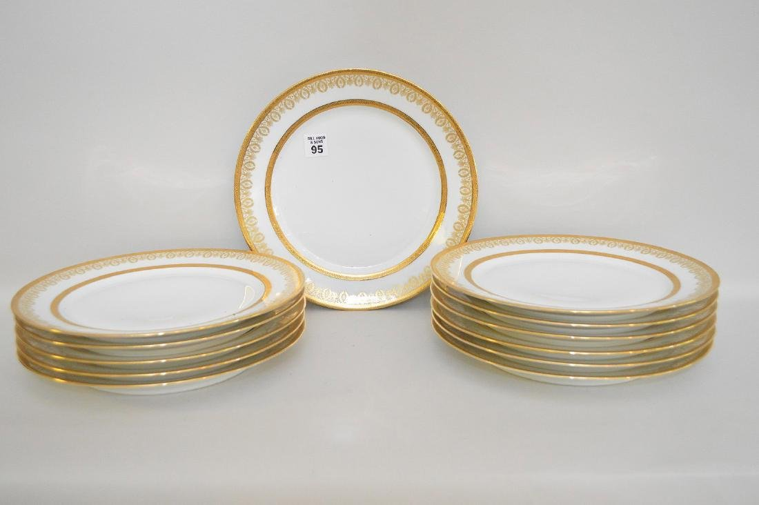 12 Limoges France dinner plates with gold wreath motif