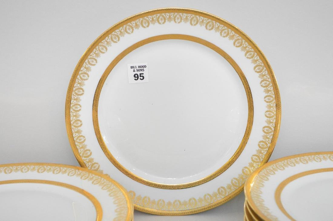 12 Limoges France dinner plates with gold wreath motif - 2