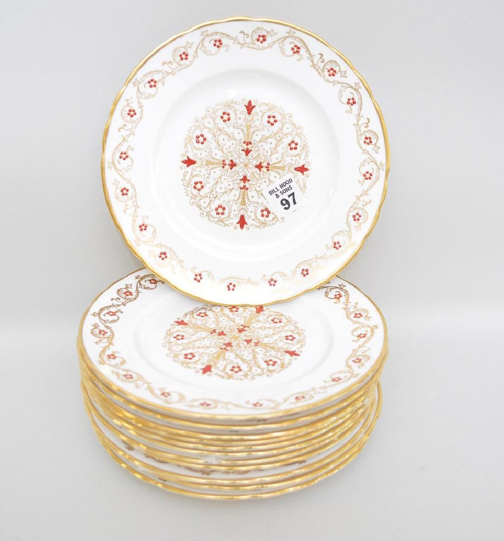 12 plates with red enamel design and gold trim (8