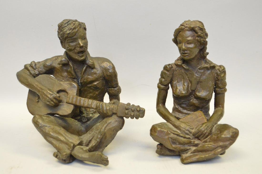 Bronze sculpture of male musicians and seated woman,