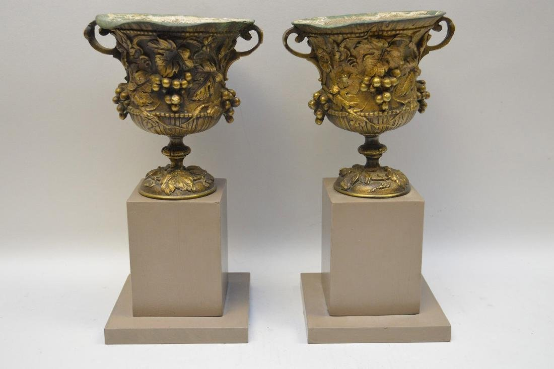 """Pair mounted bronze urns, grape motif, 9""""h overall (one"""