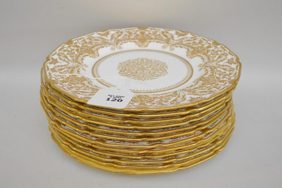 12 Royal Doulton dinner plates with heavy decorated