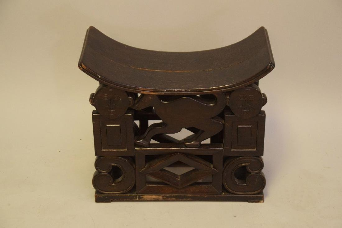 """African carved stool, crack on seat, 19""""h x 21 1/2""""w x"""