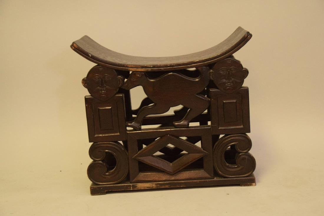 """African carved stool, crack on seat, 19""""h x 21 1/2""""w x - 2"""