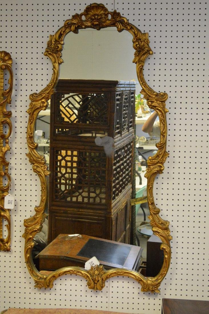 "Giltwood mirror, shell at top, 54""h x 28"" w"