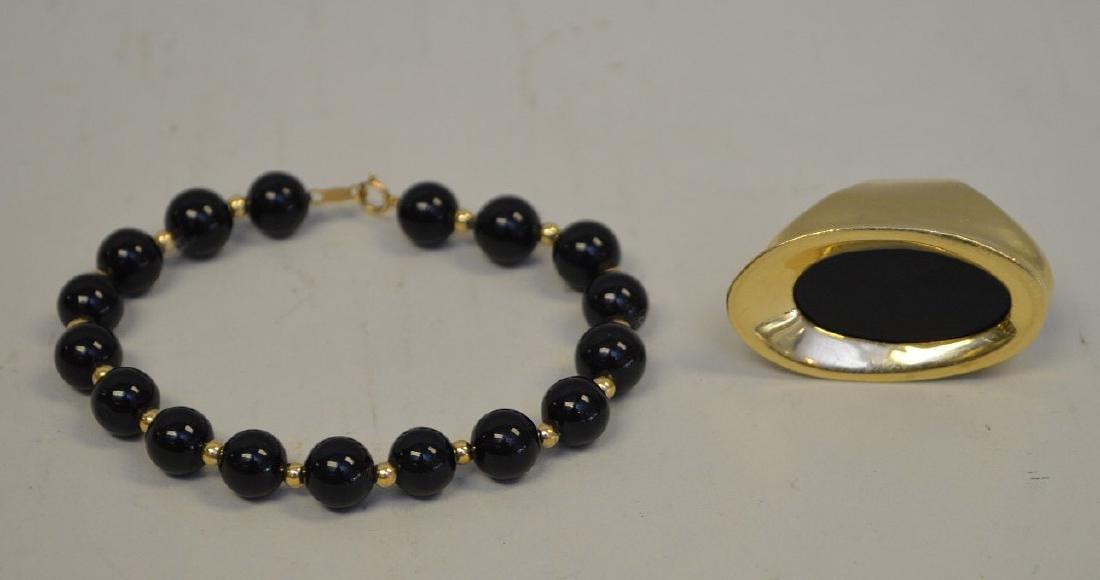 Black onyx ring, 14kt gold and beaded bracelet
