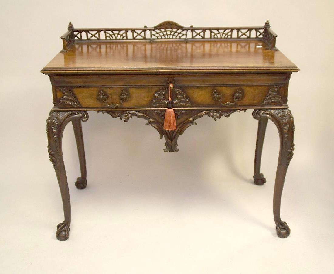 Mahogany console with fretwork gallery, single carved