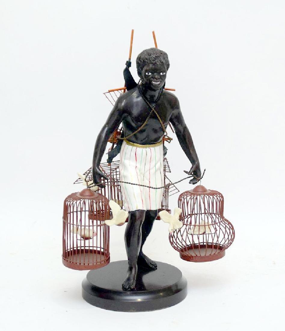 PETITE CHOSES NUBIAN BLACKAMOORE BIRD MAN