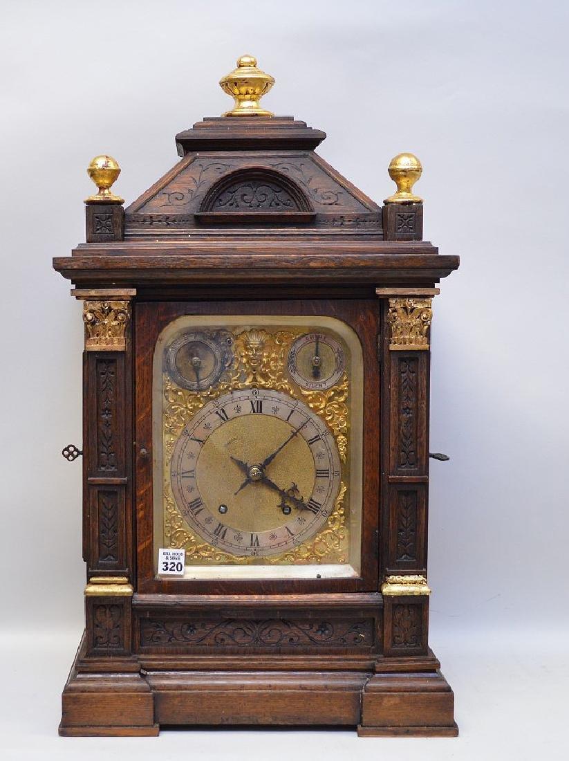 """Oak shelf clock, brass face and glass door, 27""""h"""