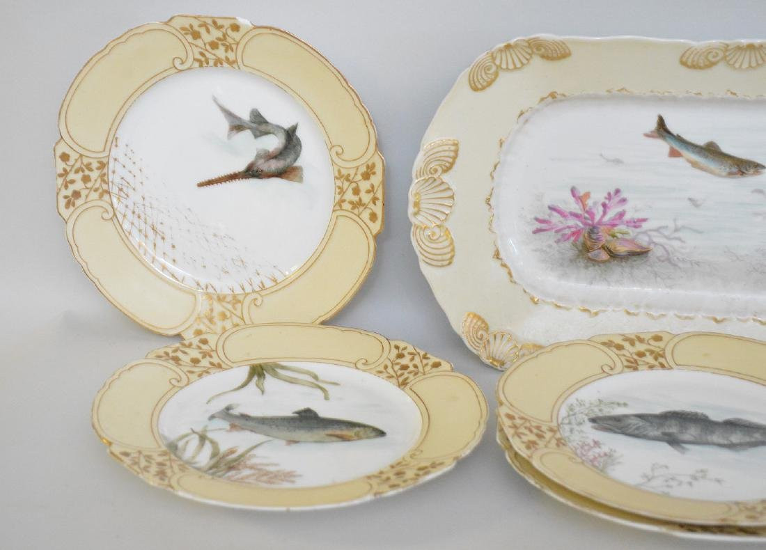 "Limoges fish set; platter (21""), 8 plates assorted - 2"