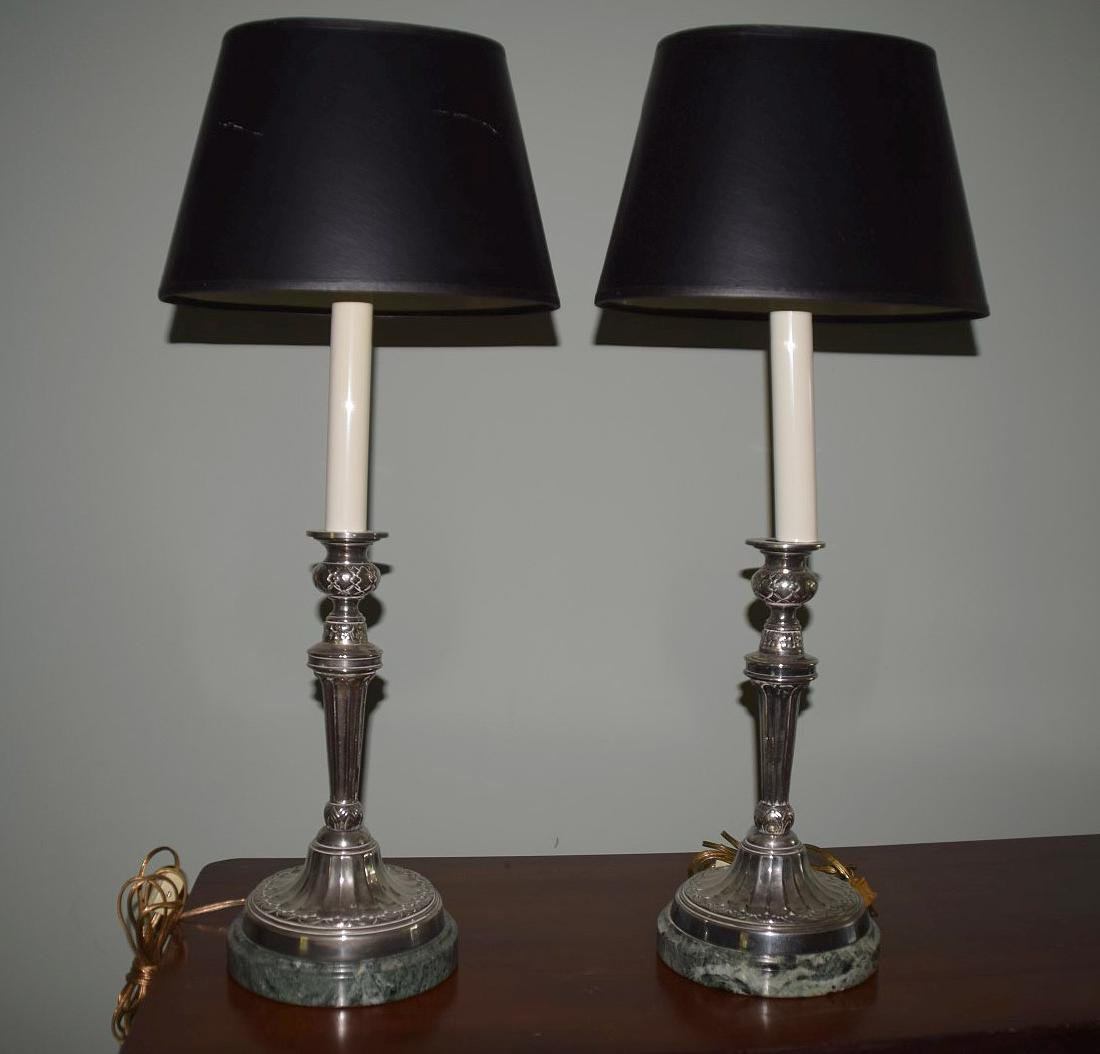 Pair of silver candlestick lamps on green marble bases,