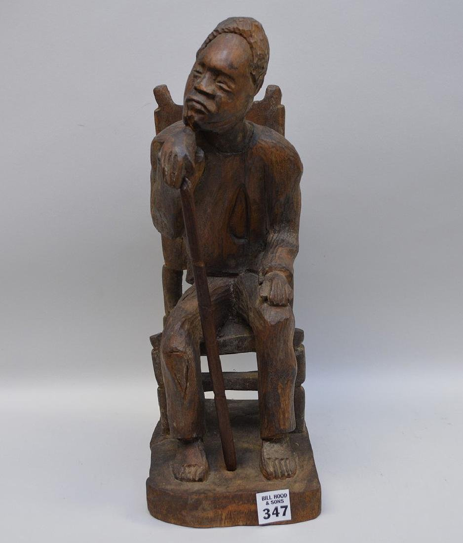 "Carved seated African American, 15""h (cane is glued)"