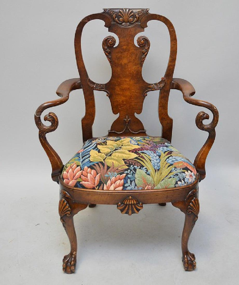 Mahogany arm chair with curving arm rests ending with