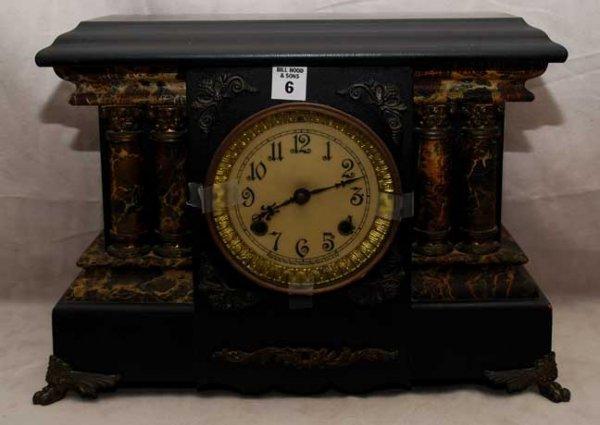 "2006: Footed mantel clock with key, 16""L x 12""h x 6""w"