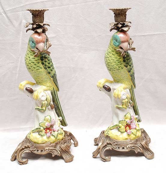 2018: Pair of bronze and porecelain parrot candlesticks