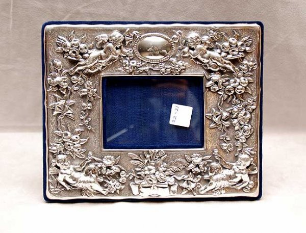 2022: Sterling heavy repose picture frame, cherub and f